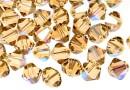 Swarovski, beads bicone xilion, light colorado topaz shimmer, 6mm - x10